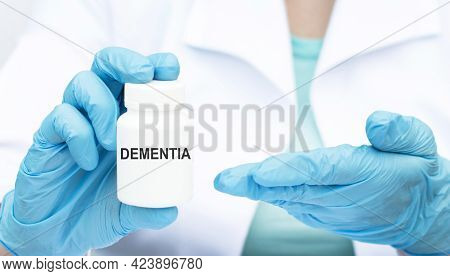 Doctor Holding A Jar With Word Dementia, Medical Concept