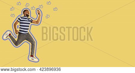 Full Length Of African Young Man Taking Phone While Jumping Against Studio Background. Mobile, Motio