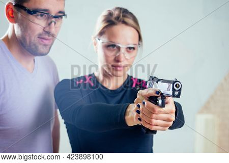 A Person Target Practicing With A Handgun For Self Defense
