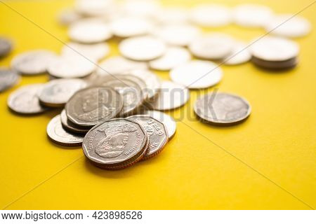 Thai Stack Coin 5 Baht On Yellow Paper Background. Growth Earn Money Investment And Saving Money Fut
