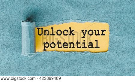 Unlock Your Potential - Words Written Under Ripped And Torn Paper.
