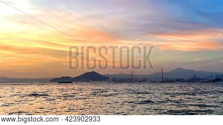 Horizontal Landscape Photograph With Ship, Bridge, Mountain, Ocean, Clouds At Sunset