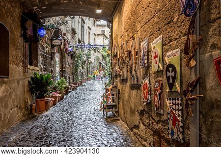 Orvieto, Italy, April 2019: Beautiful View Of Narrow Street With Small Shops, Frisky Alley Near The