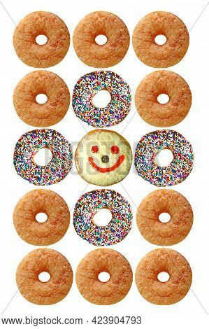 Rows Of Delectable Assorted Doughnuts On White Background