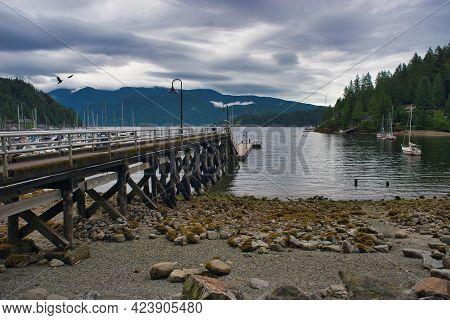 A Pier In Deep Cove On A Cloudy Day.  North Vancouver Bc Canada