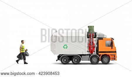 Waste collector carrying bin bags into a garbage truck isolated on white background