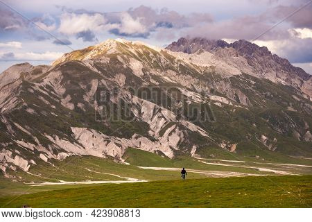 Natural Landscape With A Hiker In Mountains