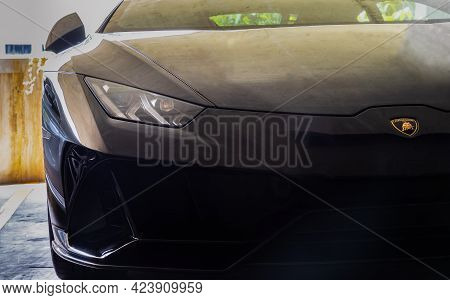 Bangkok, Thailand - 06 Jun 2021 : Close-up Of Headlights Of Black Lamborghini Sports Car. Selective