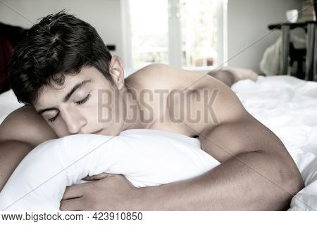 Handsome Naked Latino Man In Bed, Sleeping.