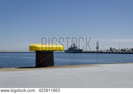 Yellow Bitt - Seaport Wharf With Warship In The Background