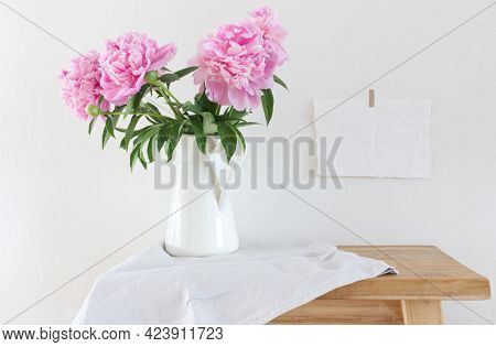 Peony Flowers In A White Vase On Old Wooden Table Background. With Copy Space For Greeting Message.