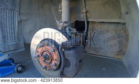 Replacing Brake Disc And Car Pad. Changing Tires. Close Up. Caliper Wheel. Safety Driving Concept. T