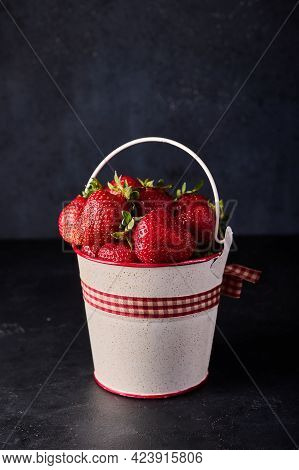 Strawberry In Light Bucket On Black Background, Vertical Orientation, Copy Space