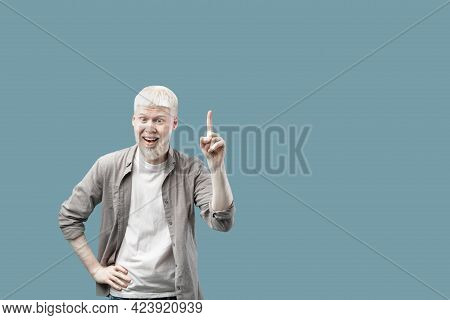 Great Idea. Excited Albino Man Pointing Finger Up, Having Aha Moment Over Turquoise Background With