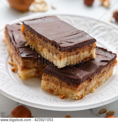 Homemade Vegan Cocoa Dates Chocolate Bars With Coconut, Hazelnuts, Walnuts And Sunflower Seeds On A