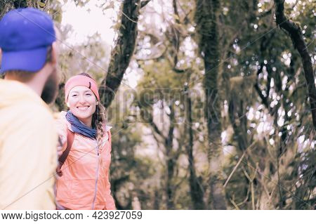 Backpackers Couple Hiking During Fall. Happy Couple Man And Woman Tourist In The Rural Camp. Holiday