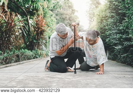 Asian Senior Woman Falling Down On Lying Floor At Home After Stumbled At The Doorstep And Crying In