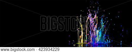 Splash of color  paint on black background banner. Abstract sculptures of colorful splashes of paint. Dancing liquid on a black background. Ink water splash. Color explosion.