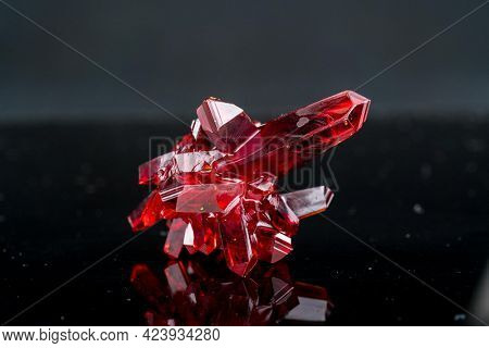 crystal of natural origin. close up of crystals in ruby color on black background