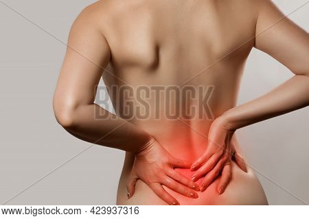 Woman Having Backache, Pain Back Isolated On Gray Background. Scoliosis. Spinal Cord Problems On Wom