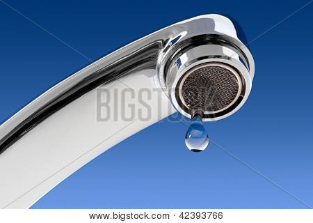 Water tap with drop, on the blue background.