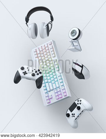 Flying Gamer Gears Like Mouse, Keyboard, Joystick, Headset, Vr Headset. Web Camera On White Table Ba