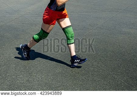 Chelyabinsk, Russia - May 30, 2021: Female Runner Athlete Running In Shoes In City Race