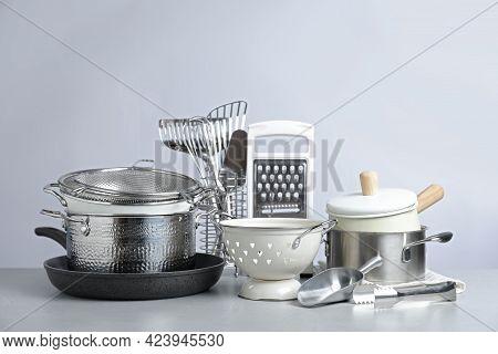 Set Of Clean Kitchenware On Light Background