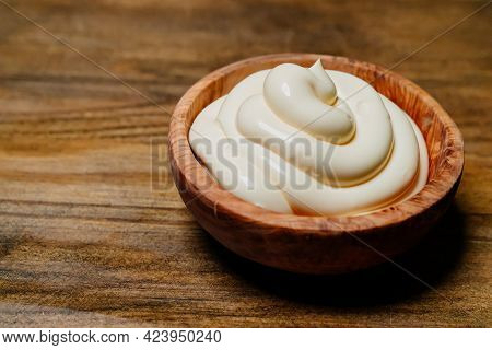 White Sauce. Small Wooden Bowl With Mayonnaise On The Kitchen Table.