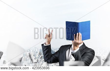 Businessman Covered Face With Organizer And Showing Fingers Victory Sign. Man In Business Suit Stand