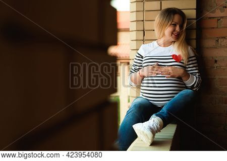 Young Preganant Woman Expecting A Baby Relaxing