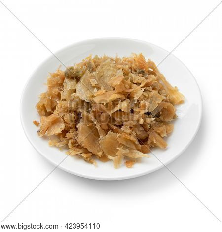 Traditional Chinese fermented cabbage on a ceramic plate close up isolated on white background
