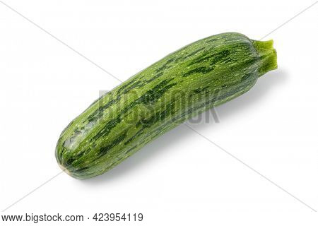 Single fresh raw green spotted courgette close up isolated on white background