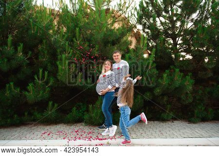 A Happy Family Is Having Fun With Your Little Child In The Park
