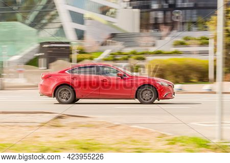 Moscow , Russia - May 2021: Red Mazda6 Sedan Third Generation Is Accelerating In Highway On Urban Ba