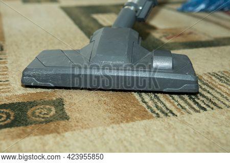 Vacuum Cleaner On The Carpet - Nozzle And Vacuum Cleaner Close-up. A Man Is Cleaning The Carpet With