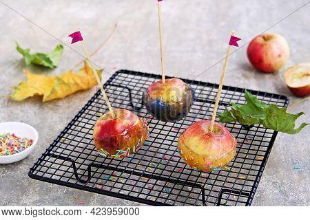 Dessert, Caramelized Candy Apples In Transparent Caramel, Sprinkled With Sugar Decor, On A Black Gra