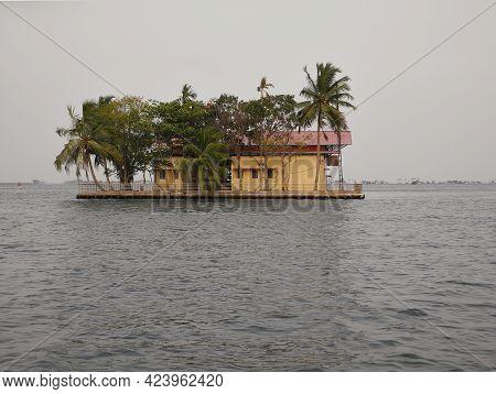 House On An Island Among Coconut Trees. India, Kerala, Cochin. Travel Concept
