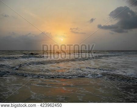 Sunset On The Background Of The Dark Gray Foaming Waves Of The Arabian Sea. India, Kerala, Cochin. T