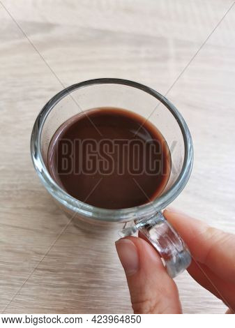Small Cup Of Hot Cocoa Or Chocolate On A Wooden Table