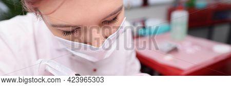 Master Cosmetologist Makes Permanent Eyelid Tattoo In Beauty Salon