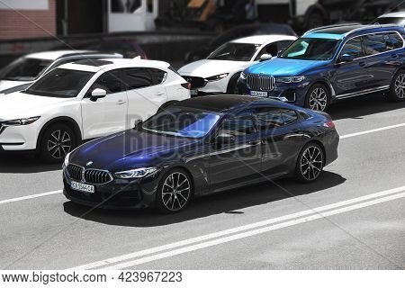 Kiev, Ukraine - May 22, 2021: Blue Bmw M850i Gran Coupe On The Road In Front Of The Bmw X7