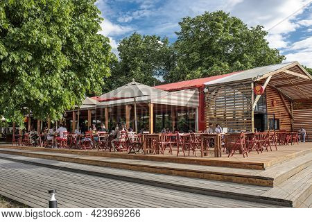 Moscow, Russia - June 15, 2021: Wooden Cafe With A Patio And A Veranda In The Gorky Park Of Culture