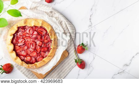 Fresh Homemade Galette With Strawberries On White Marble Background. Top View. Space For Text.