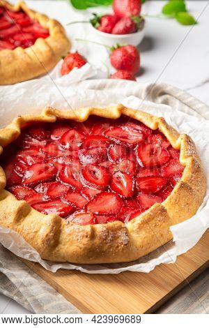 Fresh Homemade Galettes With Strawberries On White Marble Background. Selective Focus.