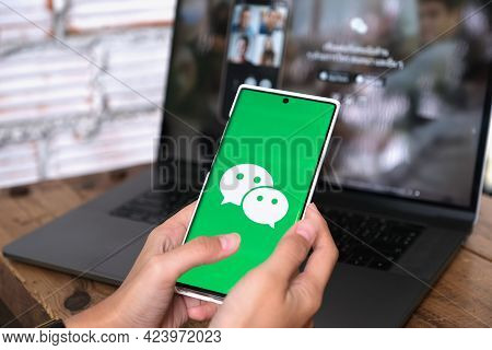 Chiang Mai, Thailand - June 06, 2021:a Woman Holds Smartphone Mobile With Wechat App On The Screen.w