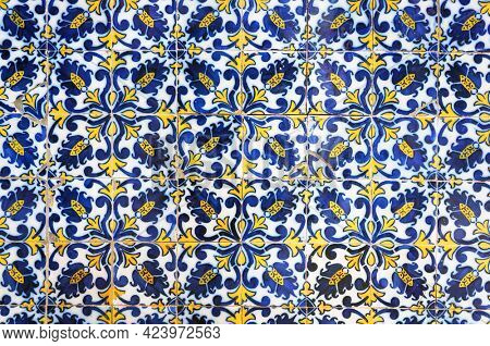 Traditional portuguese ceramic tiles azulejo on wall of old building in Funchal, Madeira, Portugal.