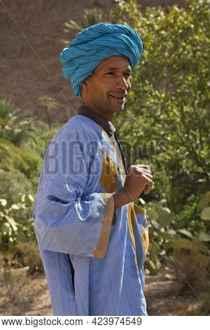 Morocco. 01 Oktober 2017.  Local Man In Traditional Dress In One Of The Oases In The Atlas Mountains