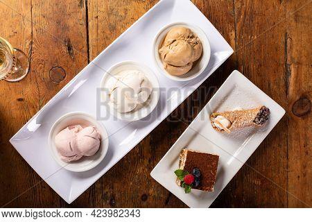 Italian Desserts On The Table, Gelato, Tiramisu And Cannoli