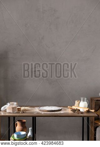 Wheat flour powder and pizza board for homemade bread cooking or baking on table. Food bread recipe at wooden tabletop background. Bakery concept in kitchen